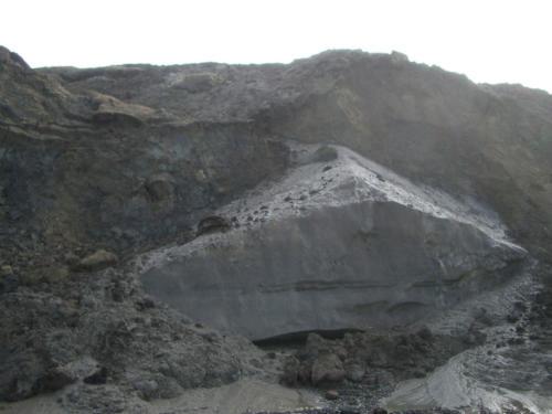 Large buried ice wedge between Utqiagvik and Walakapa, exposed by erosion. 9/1/2003.