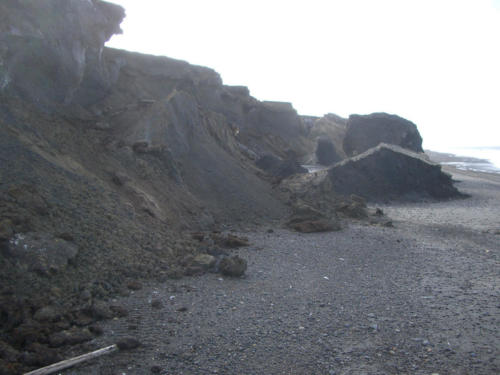 Slump blocks formed by niche collapse after melting of buried ground ice. Beach south of Utqiagvik. 9/1/2003.